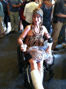 Not even a broken leg could keep Sheila off the catwalk. She ditched the wheelchair and used crutches to model her bead-curtain Cleopatra ensemble.