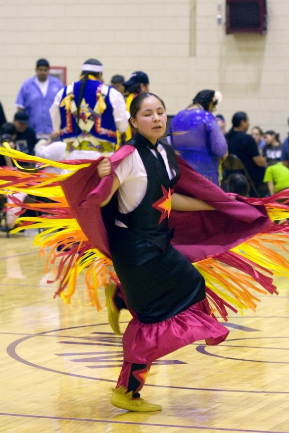 Fancy-dancing at UNM's Pit (courtesy Nic McPhee, Flikr Creative Commons)