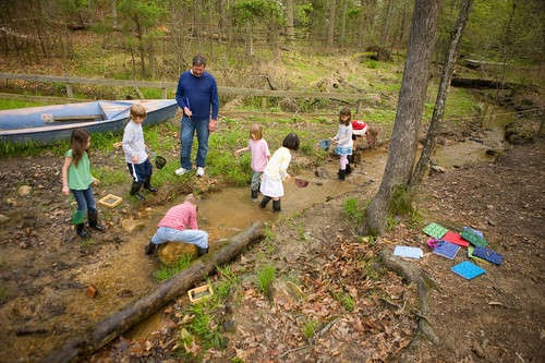 Lower School students doing some creek work.