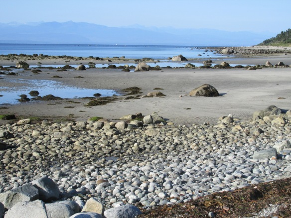 sunny Savary, with Vancouver Island in the background
